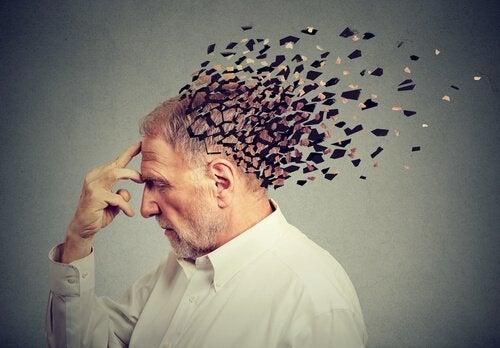 An elderly man's head breaking to pieces.