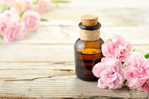 aromatherapy and a bottle of an aroma surrounded by flowers