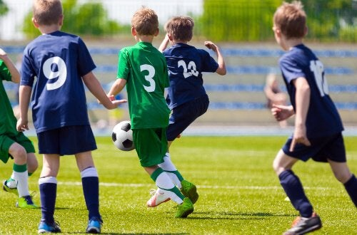 Several young boys playing soccer.