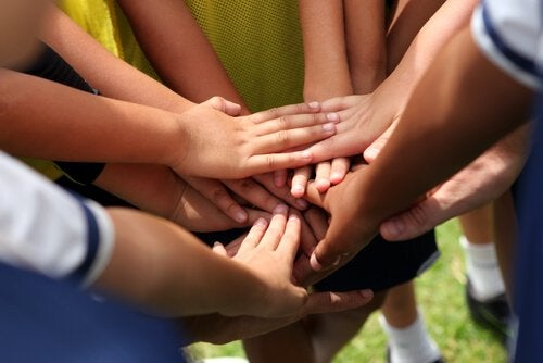 A photo of a group of hands touching.