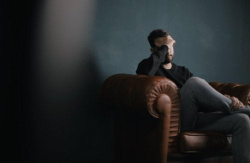 A depressed man in a therapy session.
