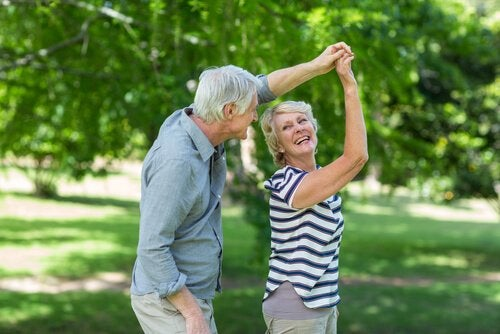 an elderly couple dancing