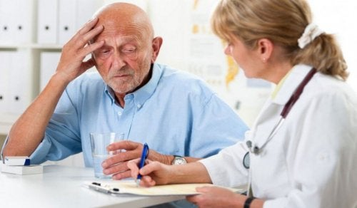 An elderly man with dementia talking to his doctor.