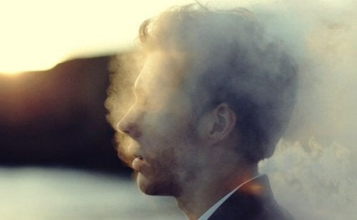 man surrounded by smoke