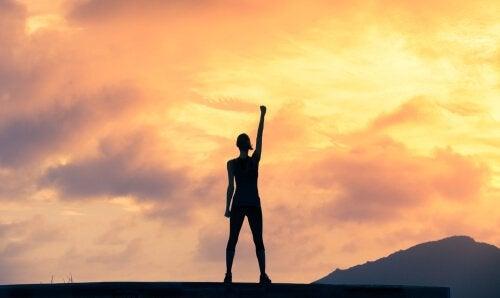 a person lifting their arm in triumph