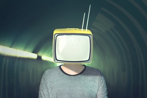A picture showing a person with a TV for a head, standing in a tunnel.