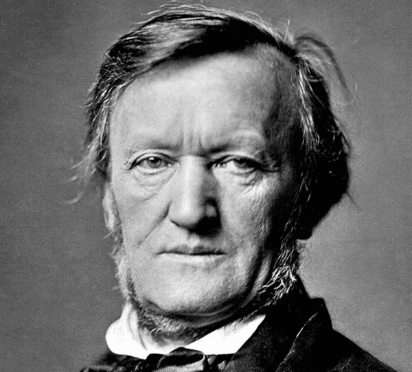 A black and white photo, showing Richard Wagner in middle-age, from the neck up, looking straight at the camera.