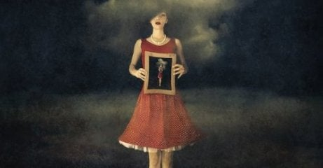 woman holding a painting that represents breaking promises