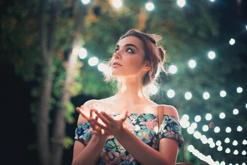 A woman surrounded by lights.