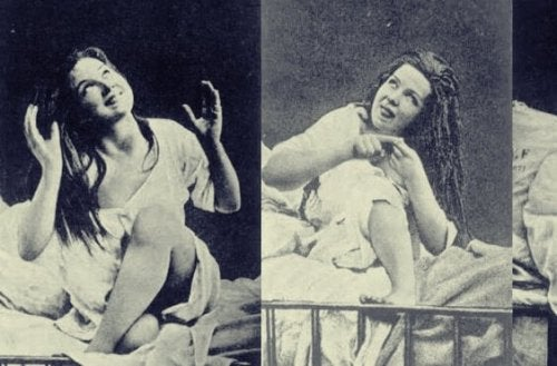 A woman with hysteria sitting on a bed.