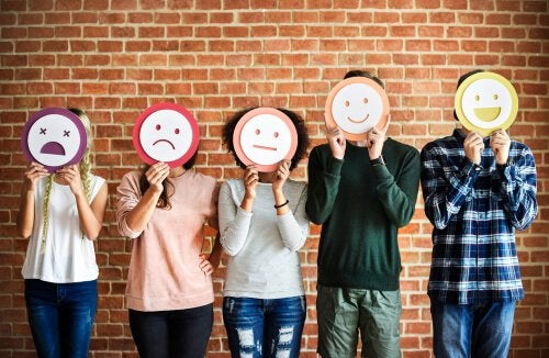 Five people with emoticon masks.