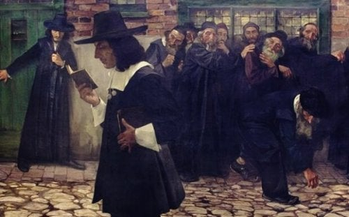 Spinoza reading in the street.