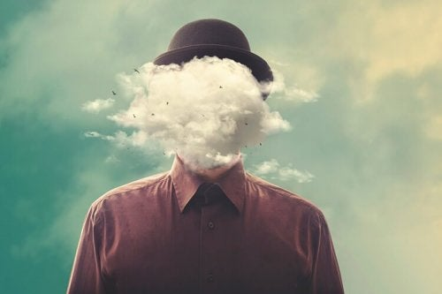 A person's face covered by clouds.