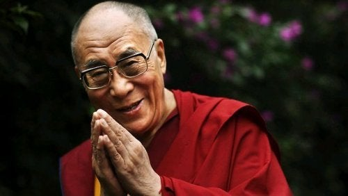 The Dalai Lama with hands in prayer.