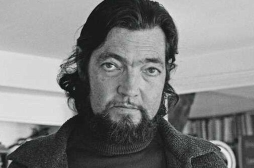 A picture showing Julio Cortázar when he was a bit older, with a beard, from the chest up.