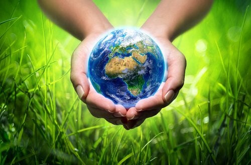 A hand holding the Earth.