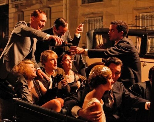 a scene from midnight in paris taking place in the 1920's