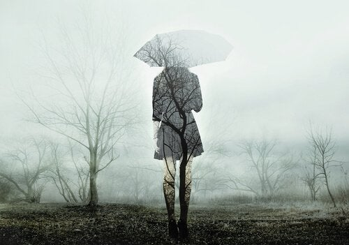 A transparent woman walking with an umbrella.