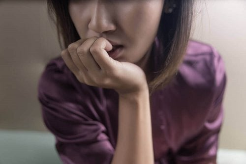 A woman with OCD biting her nails.