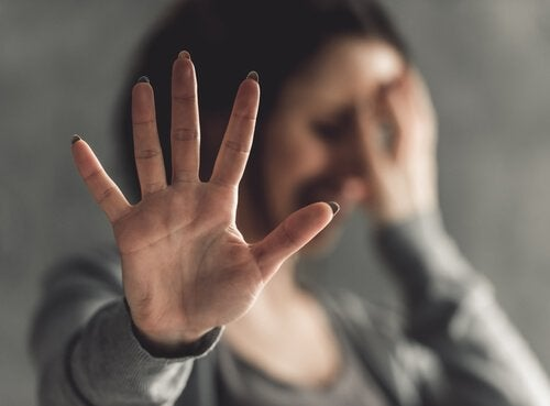 A woman defending herself against sexual violence with her hand.