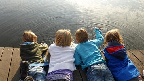 Children lying in a dock.