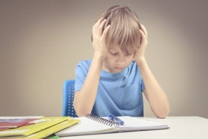 A frustrated kid doing homework.