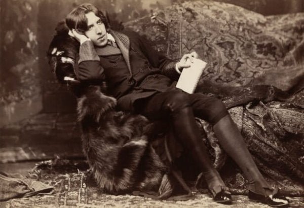 Oscar Wilde's photo of relaxing on a sofa.