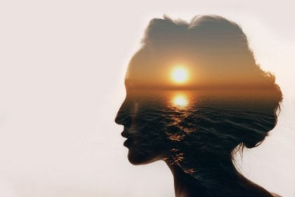 A sunset superimposed on a woman's profile.