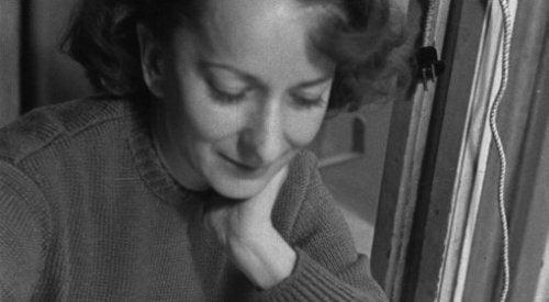 Wisława Szymborska writing.