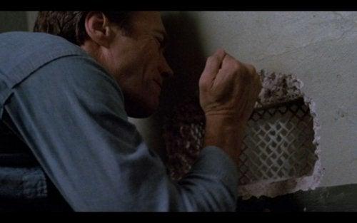 Escape from Alcatraz scene, Frank Morris digging a hole in the prison wall.