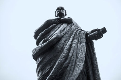 A statue of Seneca viewed from below.