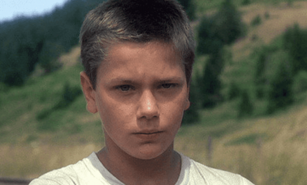 A photo of the actor looking at the camera in the movie Stand by Me.