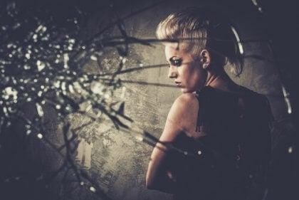 An evil woman behind a broken mirror.