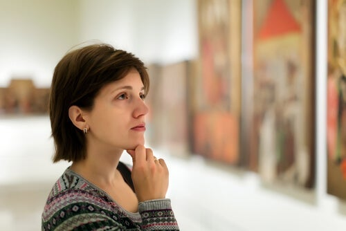 A woman looking at a picture.