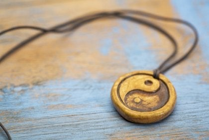 A yin and yang pendent necklace.