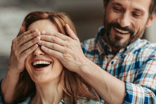 A man surprising a woman.