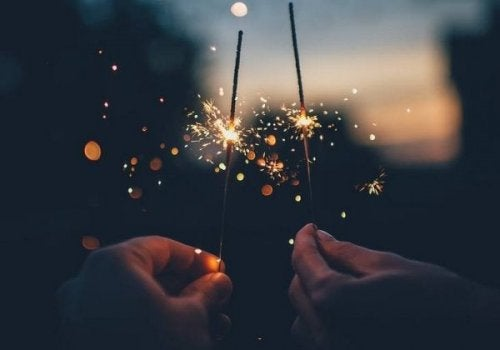 A person playing with fireworks.