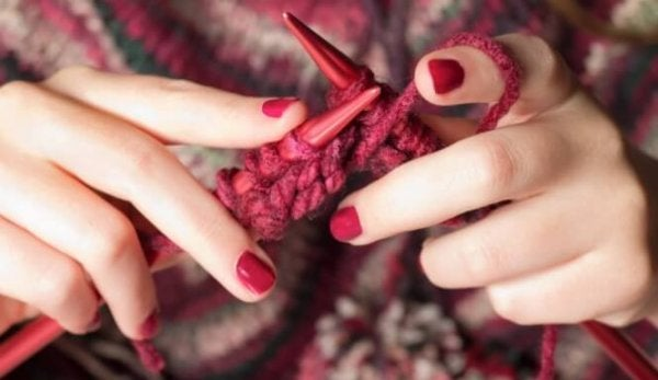 A person knitting something.