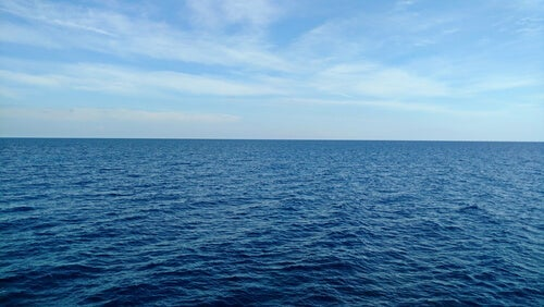A picture of the sea looking calm.