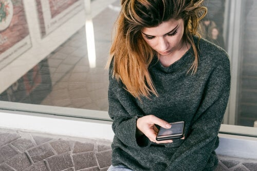 A woman looking at her phone.