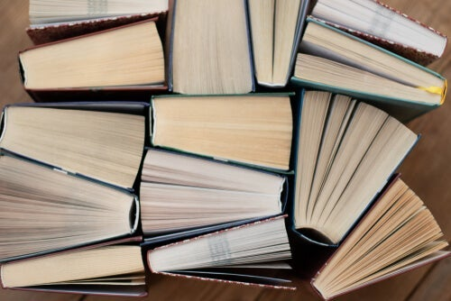 A bunch of books piled up.