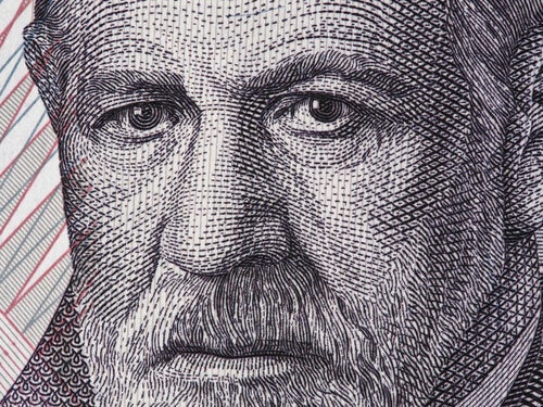 A wood print showing a close-up of Freud's face.