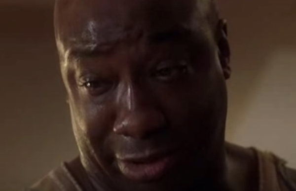 John Coffey in The Green Mile looking down, with tears in his eyes.