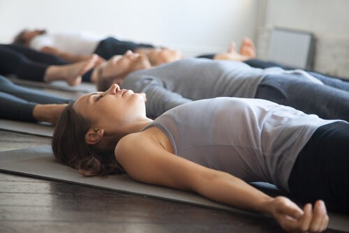 People doing relaxation exercises in a group setting.