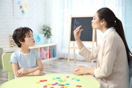 A speech therapist working with a child.