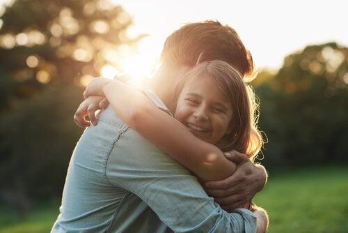 A man hugging a girl.