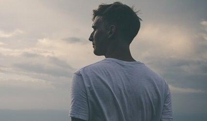 An adult man looking at the horizon.