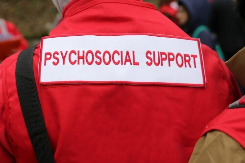 A person with a psychosocial support jacket.
