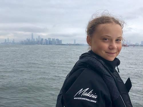 Greta Thunberg smiling.