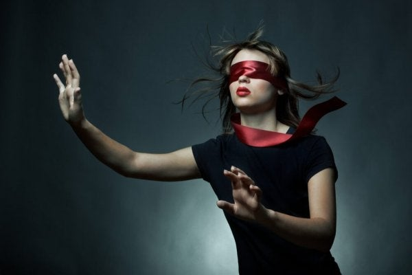A woman with a blindfold.